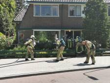 Bewoners gaan zolderbrand met tuinslang te lijf