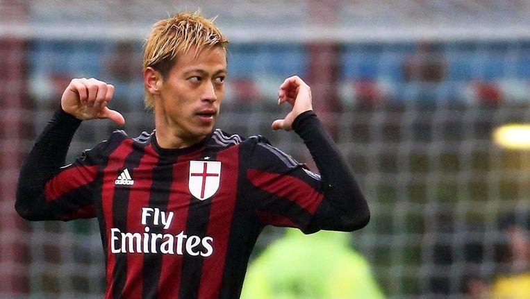 AC Milan-speler Keisuke Honda viert de 2-0. Beeld EPA