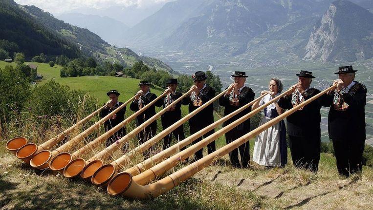 Alphornspelers in Zuid-West Zwitserland Beeld anp