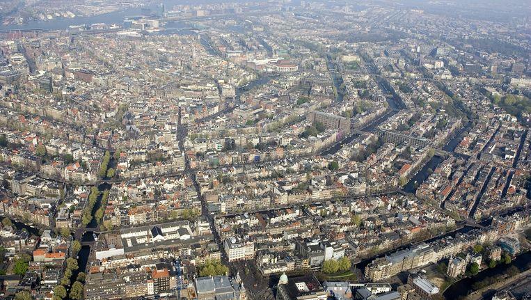 Honderden Amsterdammers gaan morgen nadenken over de toekomst van de hoofdstad. Beeld ANP