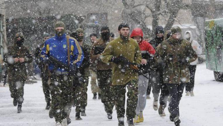 Oekraïense soldaten van het vrijwilligersbataljon Azov in de Oekraïense havenstad Marioepol.