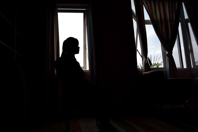 Le Thi Vu, een Vietnamese vrouw die uit een bordeel in China is gered. De vrouw werd vier maanden lang gedwongen met 12 mannen per dag seks te hebben. Zeven op de tien vastgestelde slachtoffers van mensenhandel zijn vrouwen.