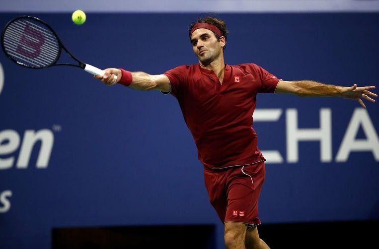 Roger Federer in zijn partij tegen John Millman.  Beeld AFP