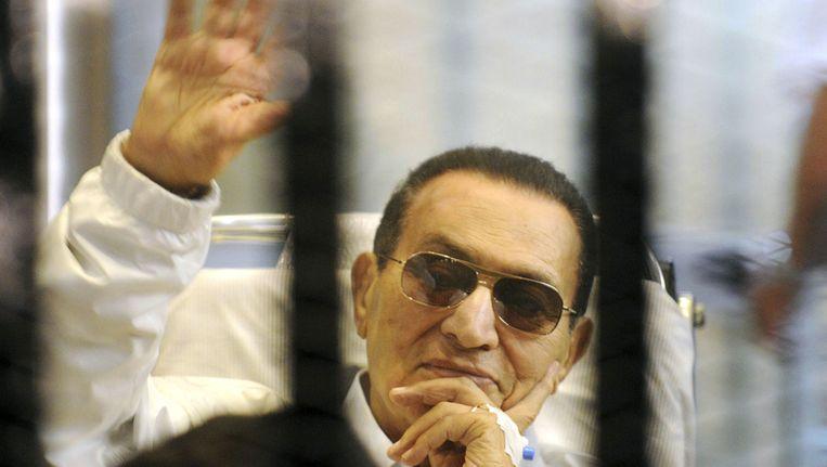 Mubarak tijdens zijn proces in Caïro, in april 2013. Beeld null