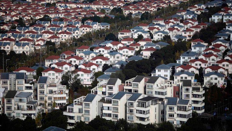 Huizen in een buitenwijk van Shanghai. Beeld REUTERS