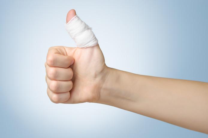 Injured painful finger with white bandage