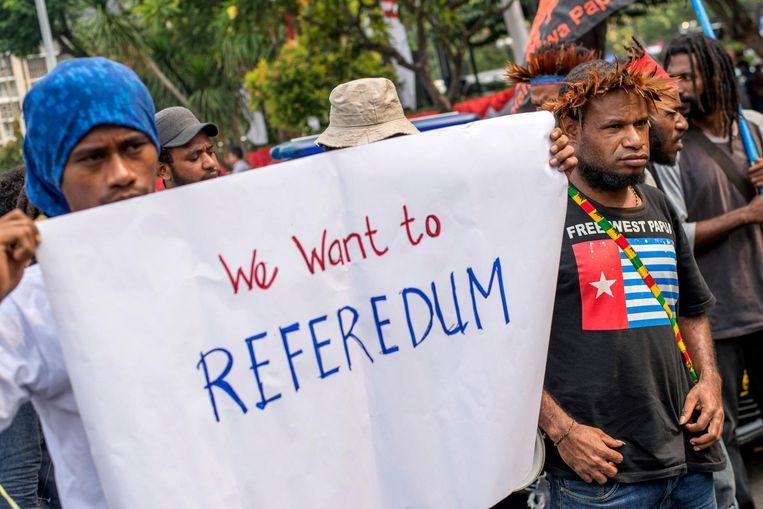 Demonstrerende Papoea's in Jakarta willen een referendum over West-Papoea. Beeld AFP