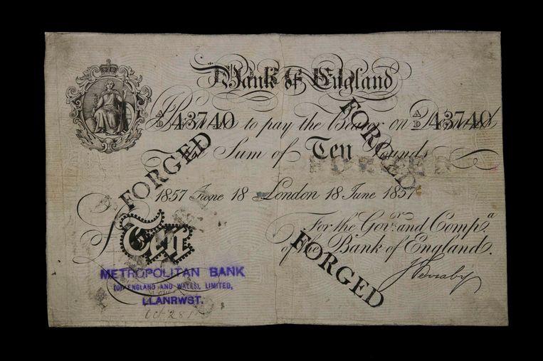 Waardepapier van de Bank of England dat is aangemerkt als een vervalsing.  Beeld Expositie Bank of England