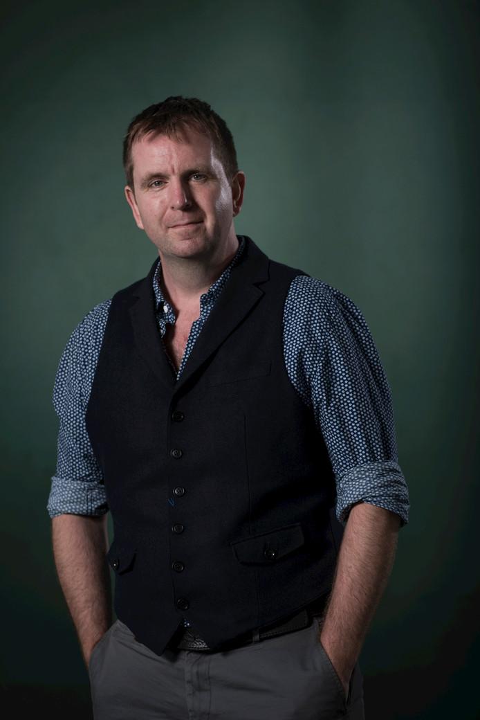 Auteur Iain Overton.