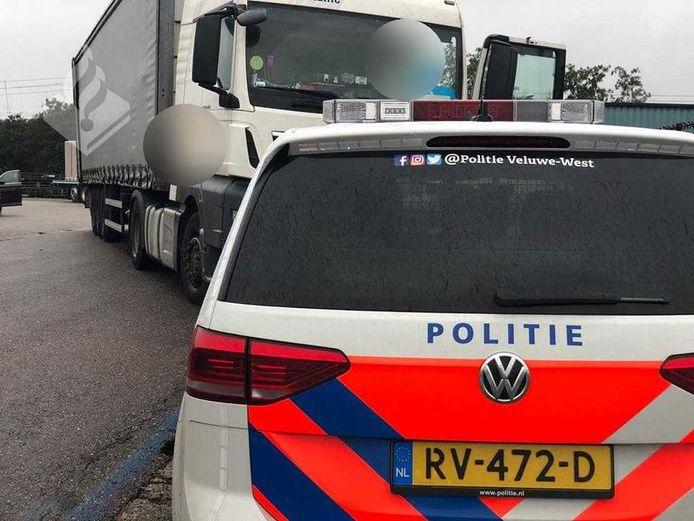 Bij een conflict zou iemand bedreigd zijn met een vuurwapen door de bestuurder van een vrachtwagen