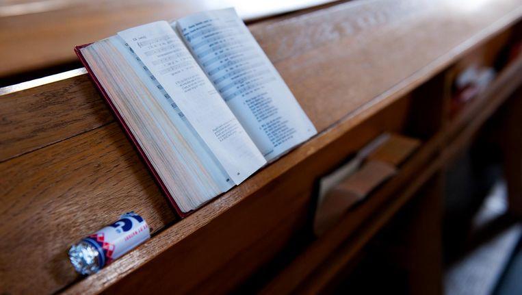 Liedboek in protestantse kerk. Beeld anp