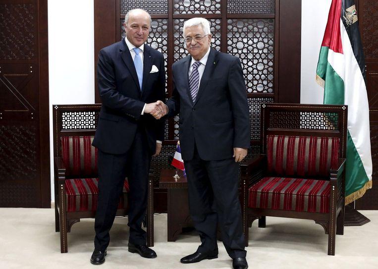 Laurent Fabius (L) met Mahmud Abbas (R).