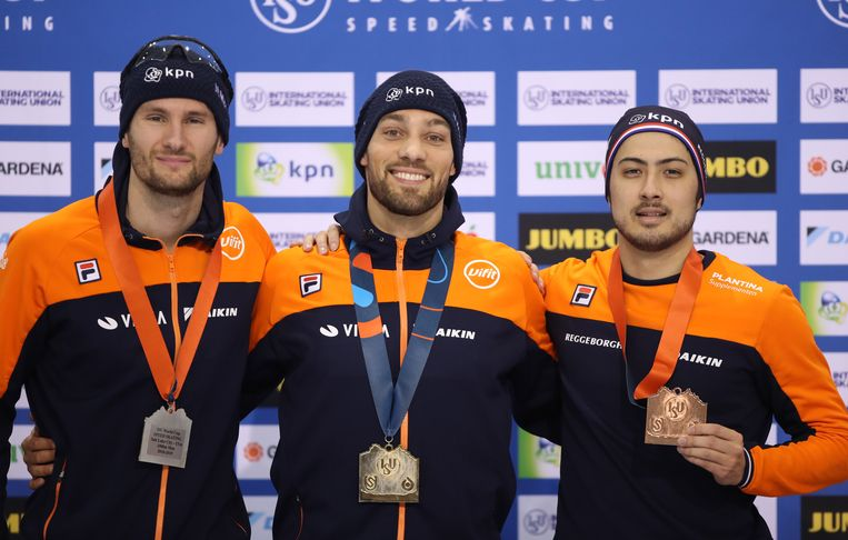 Van links naar rechts: Thomas Krol, Kjeld Nuis en Kai Verbij. Beeld EPA