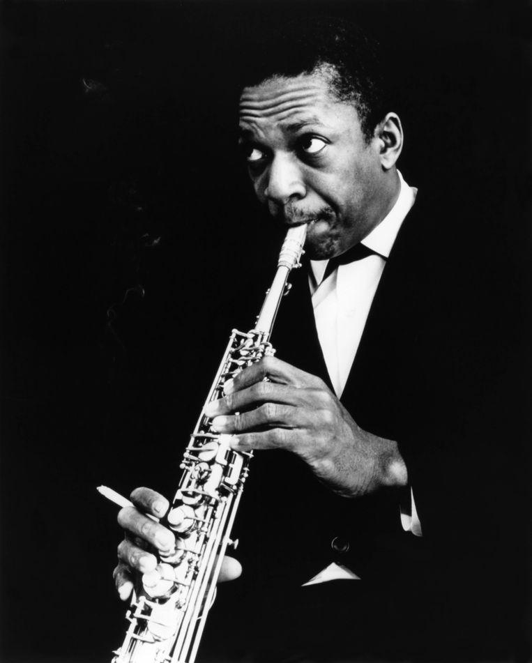 Coltrane tijdens een optreden (ca. 1960). Beeld Echoes/Redferns