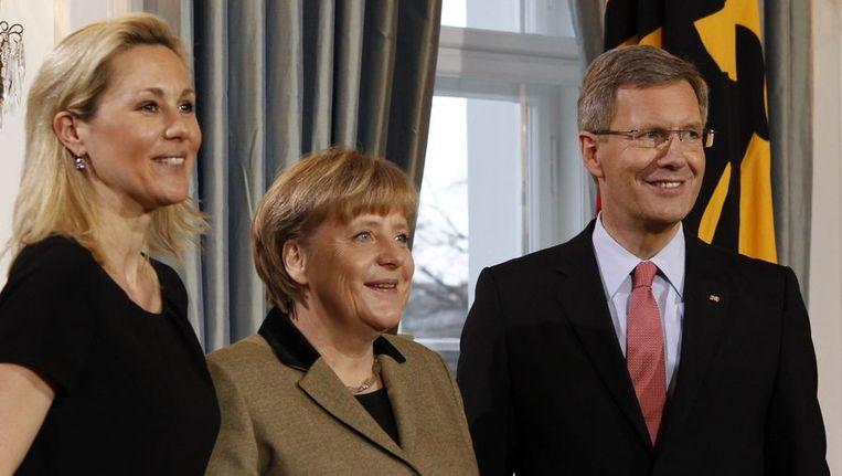 Bettina Wulff, Angela Merkel en Christian Wulff. Beeld reuters