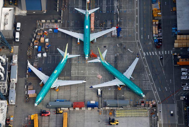Toestellen van het type Boeing 737 MAX staan geparkeerd op het terrein van de Boeing-fabriek in het Amerikaanse Renton (Washington). Beeld REUTERS