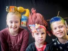 Kleurrijke kapsels tijdens Gekkeharendag op school in Angeren