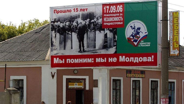 Een reclamebord in Tiraspol, 'hoofdstad' van Transnistrië: 'Wij onthouden dat we niet Moldavië zijn!' Beeld afp