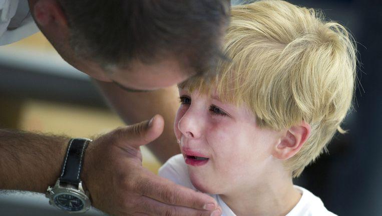 Een jongetje is in tranen op de eerste schooldag na de zomervakantie. Beeld anp
