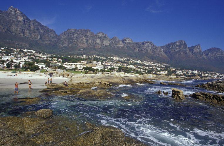Plaats: Kaapstad. 'Ik heb naast mijn huis in Londen ook een huis in Kaapstad. Het is pal aan het strand, met bergen op de achtergrond - tamelijk spectaculair.' Beeld Hollandse Hoogte