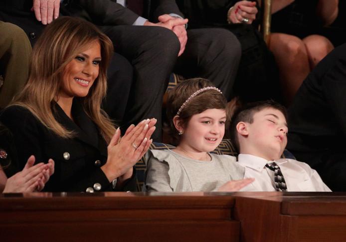 Joshua Trump (rechts) met Melania Trump en Grace Eline