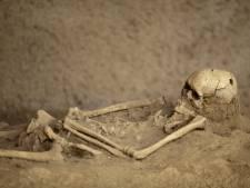 Versneden skeletten ontdekt in massagraf van de Maya's