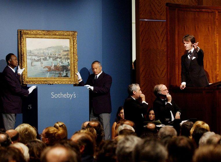 Veiling bij Sotheby's van Les Courses au Bois de Boulogne, een schilderij van Manet, dat 26.328.000 dollar opbracht. Beeld anp
