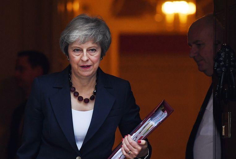 De Britse premier Theresa May wacht ongetwijfeld een politiek gevecht om voldoende steun te krijgen in het parlement.