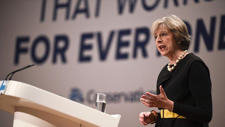 Premier Theresa May spreekt het partijcongres van de Conservatieven toe. Beeld afp