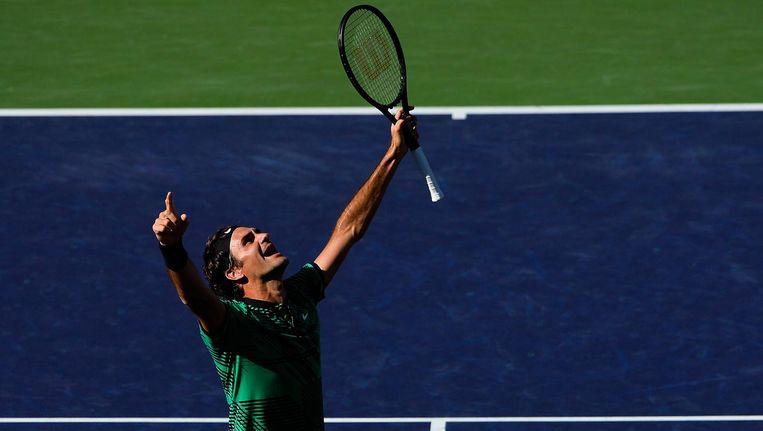 Roger Federer viert zijn overwinning. Beeld afp