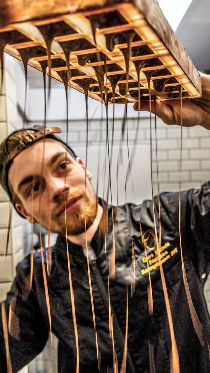 """Dries Michels: ,,Ik probeer van het traditionele af te blijven. Niet de hazelnoot-, slagroom- en likeurvulling."""""""
