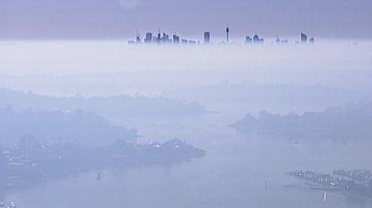 Hallucinante beelden: Sydney verdwijnt in deken van rook door bosbranden