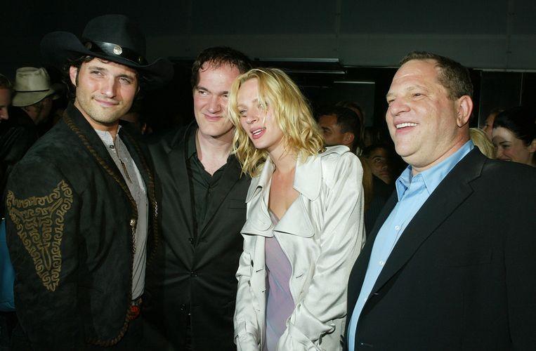 Regisseur Robert Rodriguez, Quentin Tarantino, Uma Thurman en Harvey Weinstein in 2004 na de premiere van de film Kill Bill Vol 2. Beeld afp