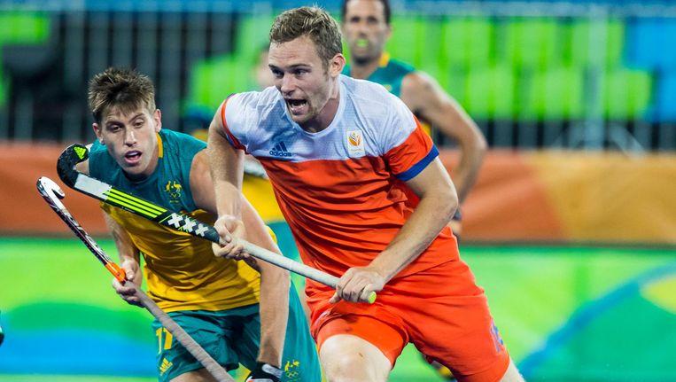 Mirco Pruyser (r) tijdens de kwartfinale hockey heren Nederland-Australie van de Olympische Spelen, 14 augustus 2016. Beeld anp