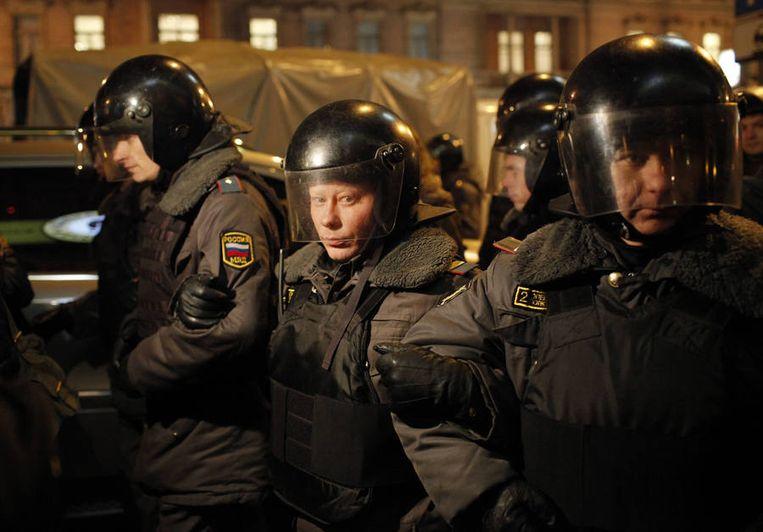 Agenten blokkeren een deel van een straat in Moskou, gisteren. Beeld ap