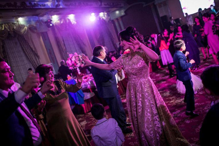 Een bruiloft in het paleis Zebu Zar in Tasjkent, de hoofdstad van Oezbekistan. Beeld null