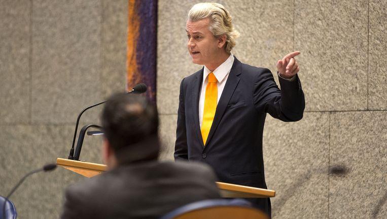 Wilders spreekt tijdens het debat over het ESM, op de voorgrond minister De Jager Beeld ANP