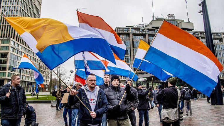 Demonstranten op het Rotterdamse stationsplein. Beeld anp
