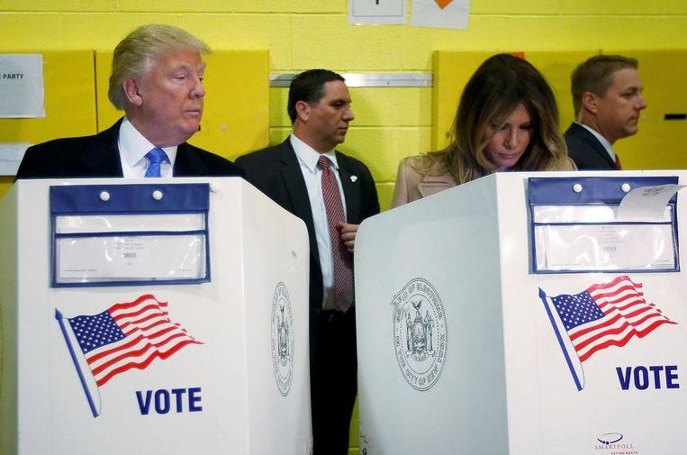 Trump en zijn vrouw Melania brengen dinsdag hun stem uit. Beeld Reuters