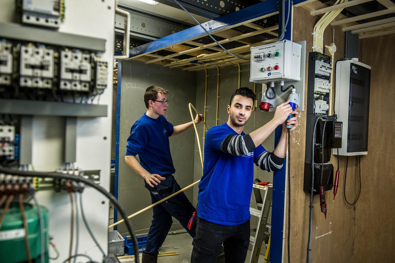 Machmoed Klall bij zijn leerwerkbedrijf. Foto Koen Verheijden.