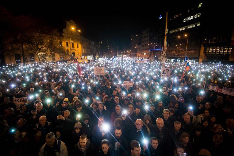 Slowaken in februari van dit jaar tijdens een optocht ter herdenking van Kuciak. Beeld AFP