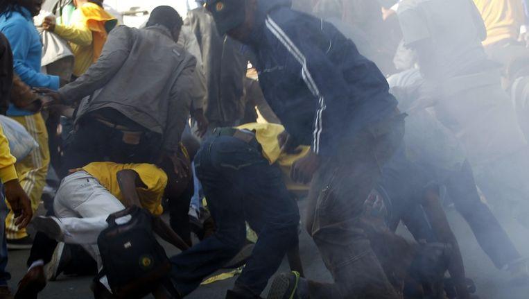 Protestanten in de verdrukking tijdens de rellen. Beeld reuters