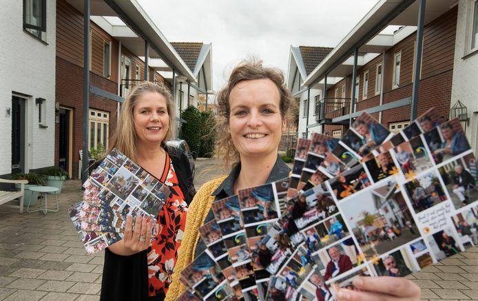 Buren Titia en Noortje met hun burendag-fotokaarten