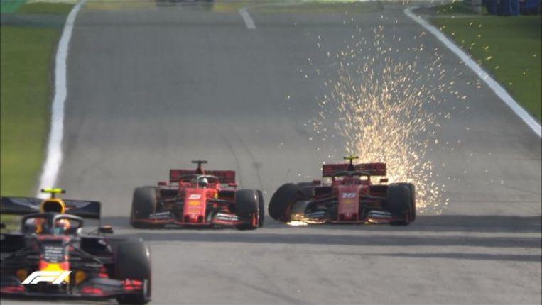 Vettel en Leclerc tikken elkaar aan en schuiven van de baan.