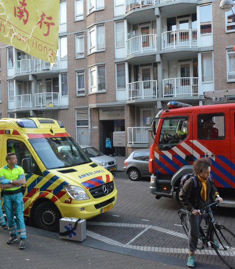 Brand in appartement Gedempte Burgwal, meerdere woningen ontruimd