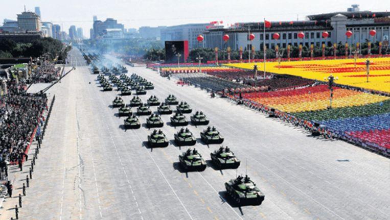 De militaire parade donderdagochtend in het zwaar beveiligde centrum van Peking. Foto AP Beeld