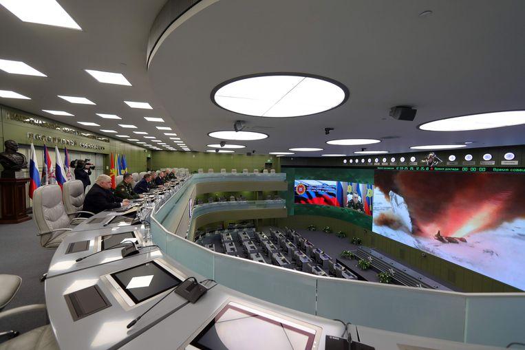 De Russische president Vladimir Poetin tijdens een eerder bezoek aan het nationale militaire controlecentrum om een testlancering van het Avangard-systeem te overschouwen.