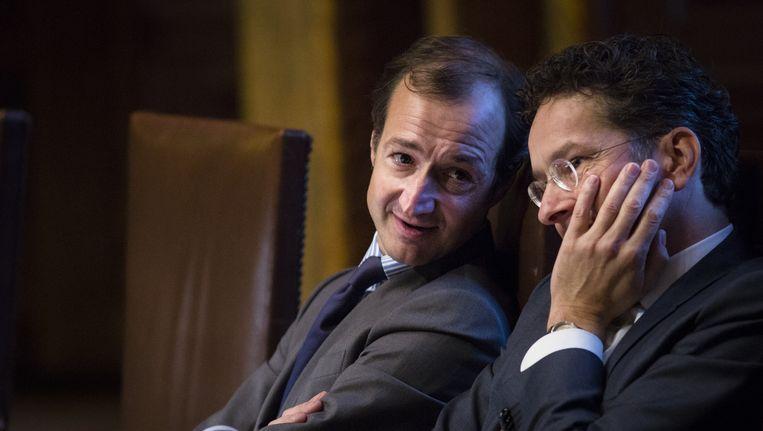 Staatssecretaris Eric Wiebes (l) en minister Jeroen Dijsselbloem van financiën tijdens de Financiële Beschouwingen in de Eerste Kamer. Beeld anp