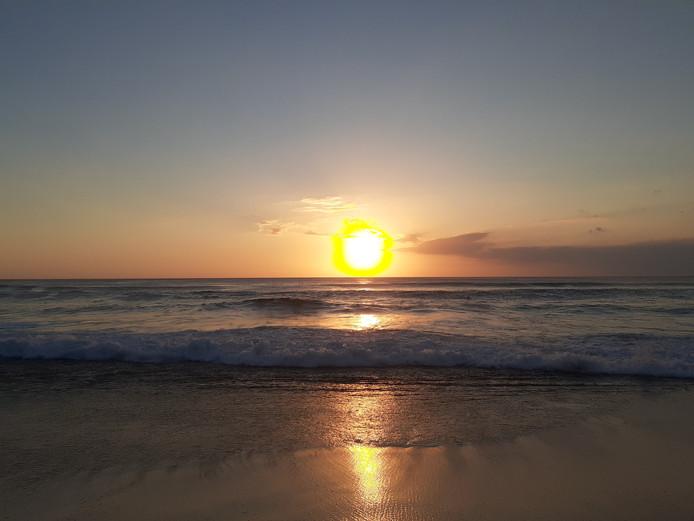 Dit is de zonsondergang op Dreamland Beach in Bali. Kan iets nog dromeriger klinken?