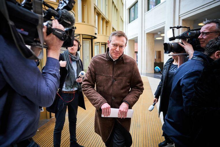 Minister Bruno Bruins voor Medische Zorg (VVD) komt aan bij het ministerie van Veiligheid en Justitie.  Beeld ANP
